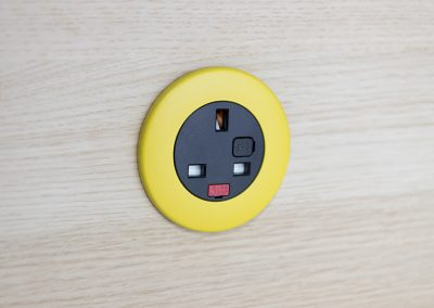 Pip in light wood with yellow bezel and black UK fused socket