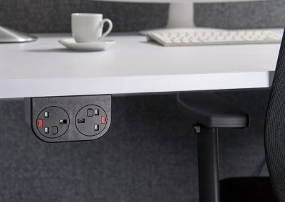 Black Phase with UK sockets mounted under desktop