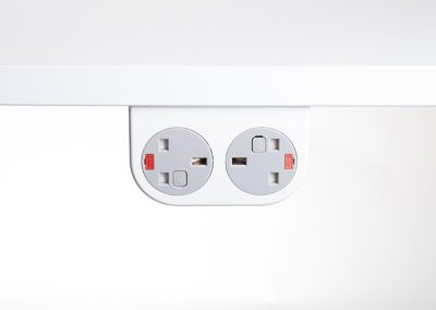 White Phase with grey UK sockets mounted under desktop