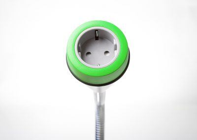 Pose with green bezel and grey Schuko socket