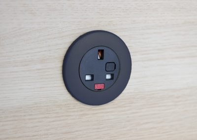 Black Pip with UK fused socket, black bezel in light wood