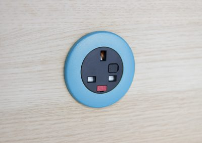 Pip in light wood with light blue bezel and black UK fused socket