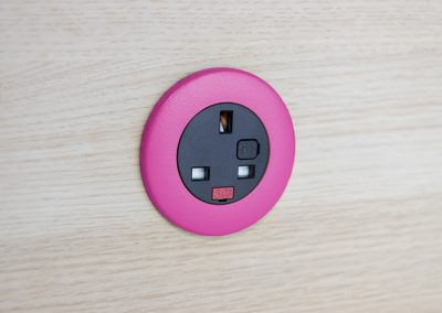 Pip in light wood with pink bezel and black UK fused socket