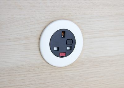 Pip in light wood with white bezel and black UK fused socket