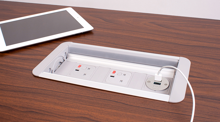 indesk oeelectrics platinum power module UK fused sockets and TUF USB Charger charging an Ipad on wooden table